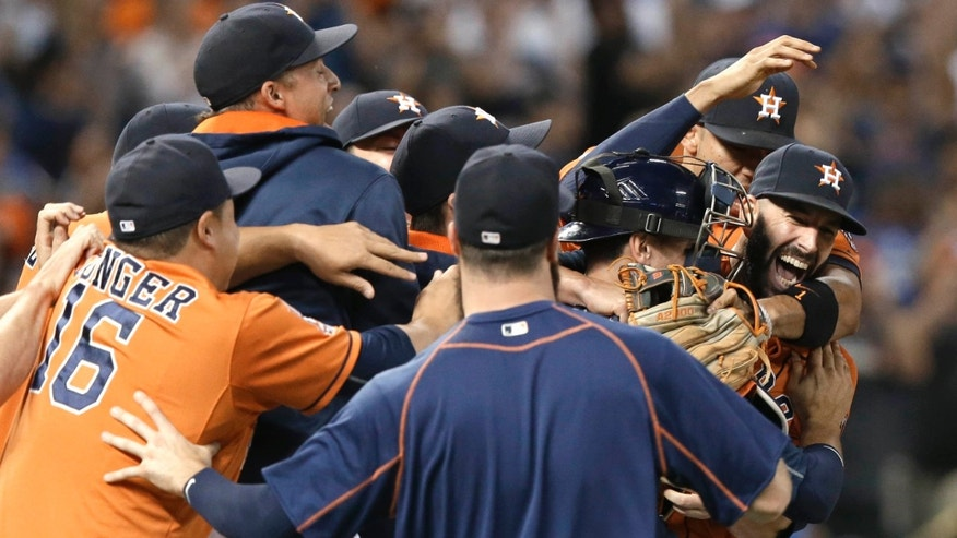 Aug. 21, 2015: Houston Astros starting pitcher Mike Fiers, right, is mobbed by teammates after his no-hitter against the Los Angeles Dodgers in a baseball game.