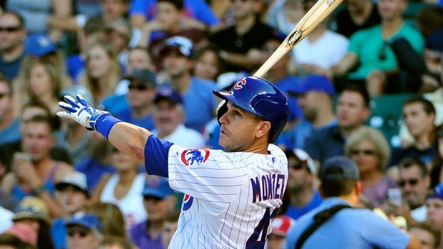 CHICAGO, IL - AUGUST 22: Miguel Montero #47 of the Chicago Cubs hits a home run against the Atlanta Braves during the eighth inning on August 22, 2015 at Wrigley Field in Chicago, Illinois. The Cubs won 9-7.(Photo by David Banks/Getty Images)