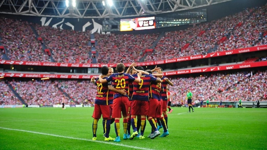 FC Barcelona's Luis Suarez of Uruguay,  center with shirt number 9, celebrates his goal with team members after scoring against Athletic Bilbao soccer team during their Spanish La Liga soccer match,  at San Mames stadium in Bilbao, northern Spain, Sunday, Aug. 23, 2015. (AP Photo/Alvaro Barrientos)