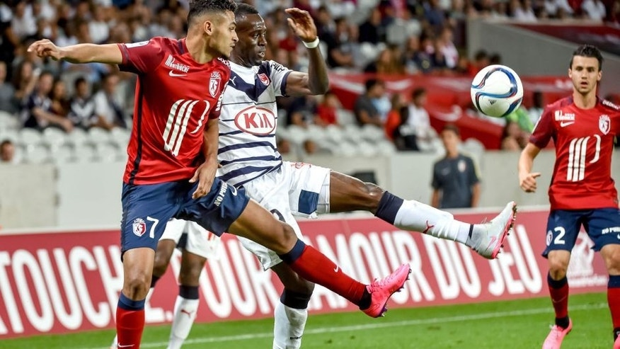 Lille's French midfielder Sofiane Boufal (L) vies with Bordeaux's French defender Maxime Poundje during the French L1 football match between Lille and Bordeaux on August 23, 2015 at the Pierre Mauroy Stadium in Villeneuve d'Ascq, northern france. AFP PHOTO / PHILIPPE HUGUEN (Photo credit should read PHILIPPE HUGUEN/AFP/Getty Images)