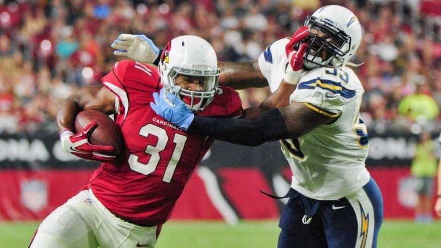 Aug 22, 2015; Glendale, AZ, USA; Arizona Cardinals running back David Johnson (31) carries the ball as San Diego Chargers inside linebacker Kavell Conner (53) defends during the first half at University of Phoenix Stadium. Mandatory Credit: Matt Kartozian-USA TODAY Sports