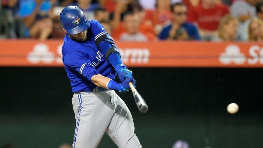 Toronto Blue Jays' Josh Donaldson hits an RBI single during the fourth inning of a baseball game against the Los Angeles Angels, Saturday, Aug. 22, 2015, in Anaheim, Calif. (AP Photo/Mark J. Terrill)