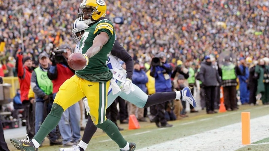 Jan 11, 2015; Green Bay, WI, USA; Green Bay Packers wide receiver Davante Adams (17) scores a touchdown against the Dallas Cowboys in the third quarter in the 2014 NFC Divisional playoff football game at Lambeau Field. Mandatory Credit: Jeff Hanisch-USA TODAY Sports