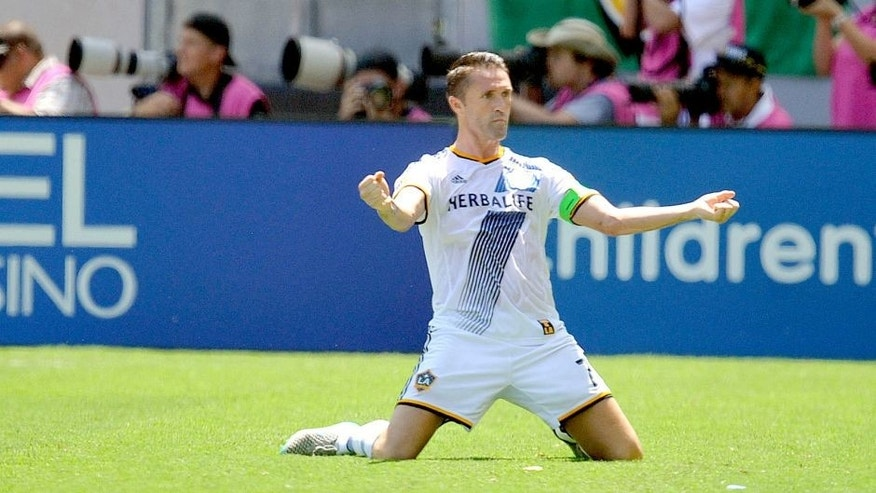August 23, 2015; Carson, CA, USA; Los Angeles Galaxy forward Robbie Keane (7) reacts to the goal scored by forward Gyasi Zardes (11) against New York City FC during the first half at StubHub Center. Mandatory Credit: Gary A. Vasquez-USA TODAY Sports