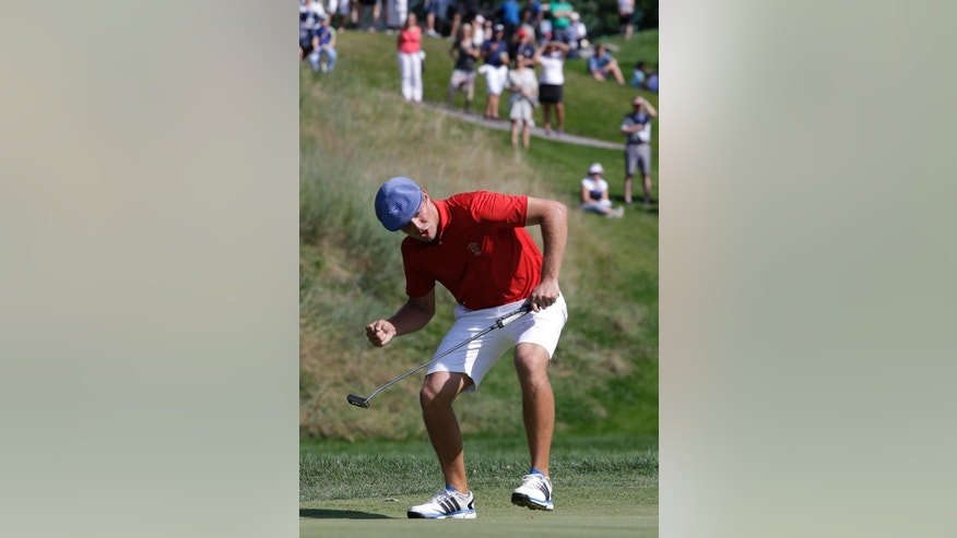 Bryson DeChambeau reacts after making a par on the 25th green during the final rmatch of the U.S. Amateur golf tournament at Olympia Fields Country Club on Sunday, Aug. 23, 2015, in Olympia Fields, Ill. DeChambeau defeated Derek Bard 7 and 6.. (AP Photo/Nam Y. Huh)