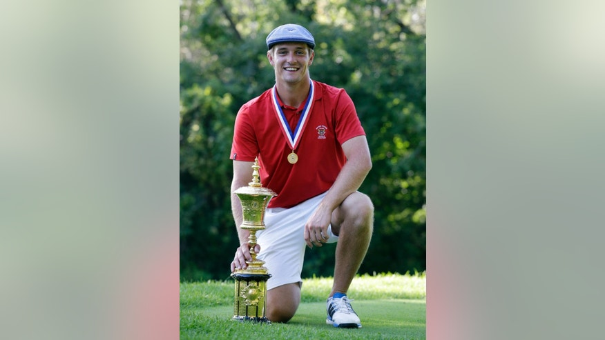 Bryson DeChambeau poses with the trophy after winning the 115th U.S. Amateur Championship golf match at Olympia Fields Country Club on Sunday, Aug. 23, 2015, in Olympia Fields, Ill. (AP Photo/Nam Y. Huh)