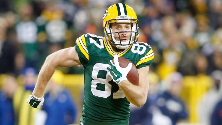 Nov 30, 2014; Green Bay, WI, USA; Green Bay Packers wide receiver Jordy Nelson (87) catches a touchdown pass during the first half against the New England Patriots at Lambeau Field. Mandatory Credit: Chris Humphreys-USA TODAY Sports