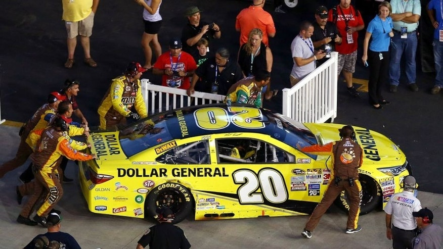 BRISTOL, TN - AUGUST 22: Crew members push Matt Kenseth, driver of the #20 Dollar General Toyota, into the garage during the NASCAR Sprint Cup Series IRWIN Tools Night Race at Bristol Motor Speedway on August 22, 2015 in Bristol, Tennessee. (Photo by Tom Pennington/Getty Images)