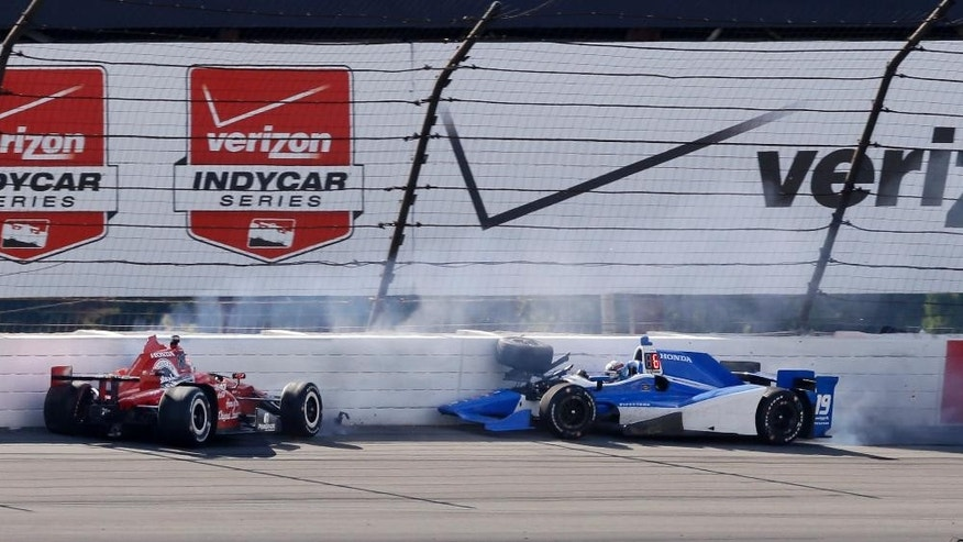 Graham Rahal, left, and Tristan Vautier, of France, hit the wall in Turn 3 after colliding during the Pocono IndyCar 500 auto race Sunday, Aug. 23, 2015, in Long Pond, Pa. (AP Photo/Mel Evans)