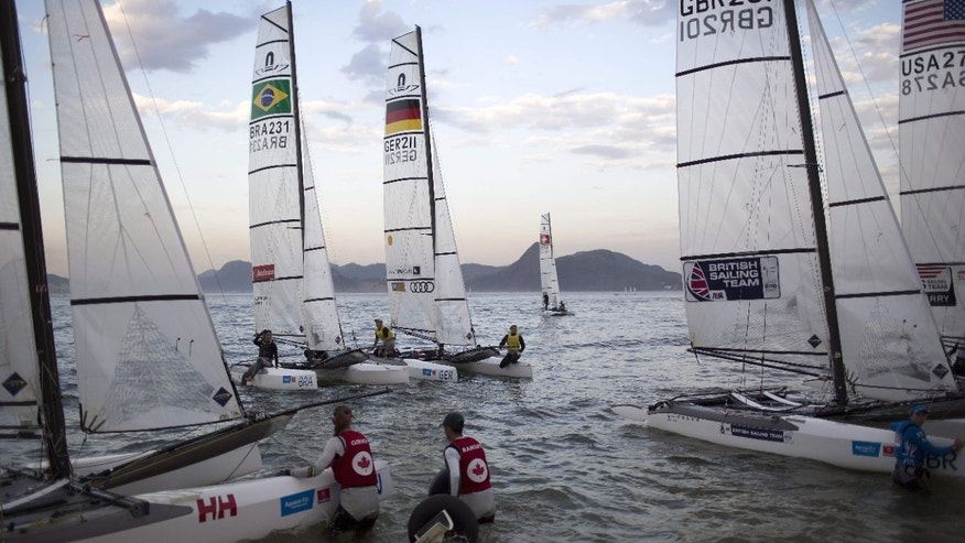 Aug. 19, 2015: Athletes from the Nacra 17 Mixed Multihull class return to Flamengo beach after competing in a sailing test event for the Rio 2016 Olympic Games in Guanabara Bay, Rio de Janeiro, Brazil.