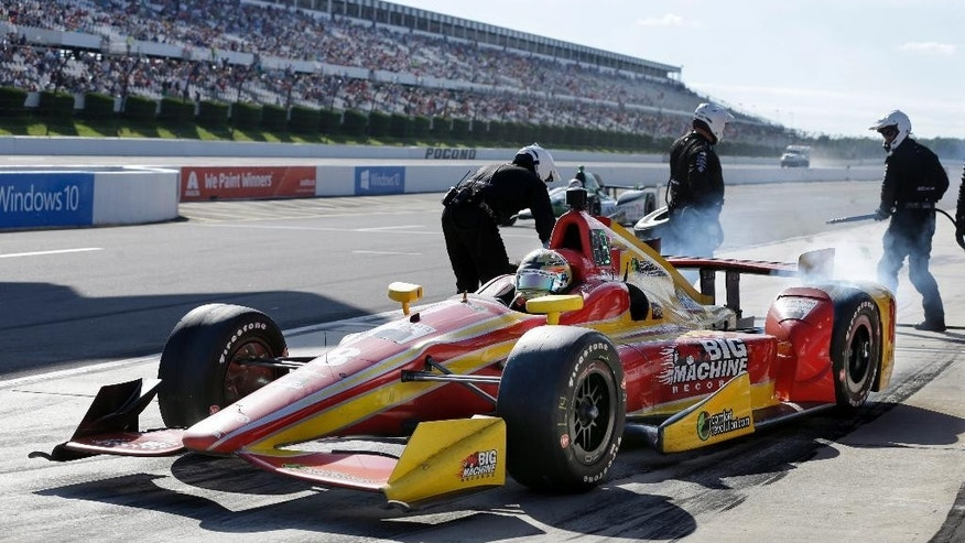 Sage Karam (8) accelerates from a pit stop during the Pocono IndyCar 500 auto race Sunday, Aug. 23, 2015, in Long Pond, Pa. (AP Photo/Mel Evans)