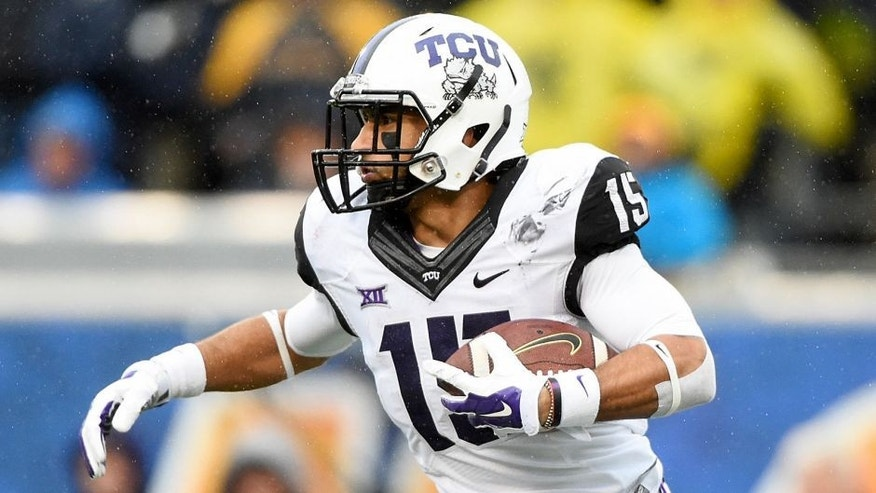 Nov 1, 2014; Morgantown, WV, USA; TCU Horned Frogs wide receiver Cameron Echols-Luper (15) returns a kick during the second quarter against the West Virginia Mountaineers at Milan Puskar Stadium. TCU Horned Frogs defeated West Virginia Mountaineers 31-30. Mandatory Credit: Tommy Gilligan-USA TODAY Sports
