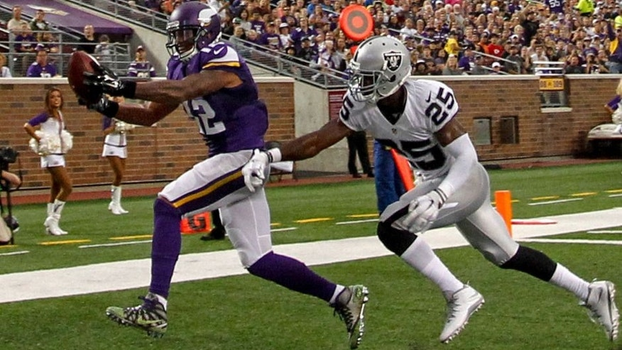 <p>Aug 22, 2015; Minneapolis, MN, USA; Minnesota Vikings wide receiver Charles Johnson (12) catches a pass past Oakland Raiders cornerback D.J. Hayden (25) for a touchdown in the second quarter at TCF Bank Stadium. Mandatory Credit: Bruce Kluckhohn-USA TODAY Sports</p>