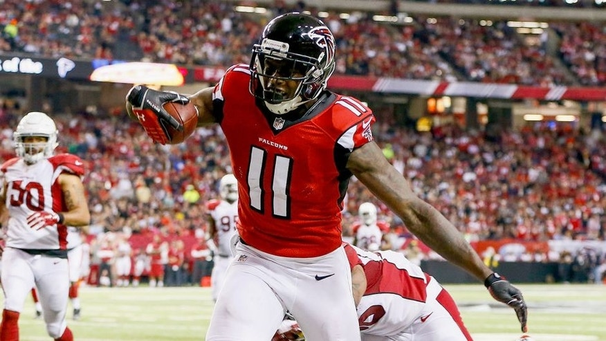 ATLANTA, GA - NOVEMBER 30: Julio Jones #11 of the Atlanta Falcons catches a pass during the first half against the Arizona Cardinals at the Georgia Dome on November 30, 2014 in Atlanta, Georgia. (Photo by Kevin C. Cox/Getty Images)