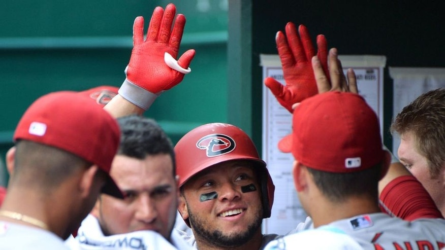 CINCINNATI, OH - AUGUST 23: Wellington Castillo #7 of the Arizona Diamondbacks celebrates his solo home run in the fourth inning against the Cincinnati Reds at Great American Ball Park on August 23, 2015 in Cincinnati, Ohio. Arizona defeated Cincinnati 4-0. (Photo by Jamie Sabau/Getty Images)