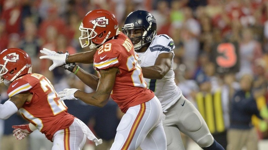Aug 21, 2015; Kansas City, MO, USA; Kansas City Chiefs strong safety Eric Berry (29) rushes as Seattle Seahawks wide receiver Kevin Smith (17) defends during the second half at Arrowhead Stadium. The Chiefs won 14-13. Mandatory Credit: Denny Medley-USA TODAY Sports