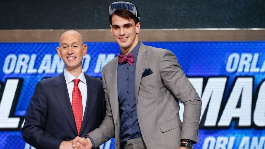 CORRECTS TEAM TO ORLANDO MAGIC, INSTEAD OF DENVER NUGGETS - Dario Saric of Croatia, right, poses for a photo with NBA Commissioner Adam Silver after being selected 12th overall by the Orlando Magic during the NBA basketball draft, Thursday, June 26, 2014, in New York. (AP Photo/Jason DeCrow)