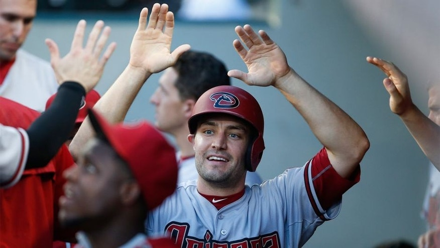 Jul 28, 2015; Seattle, WA, USA; Arizona Diamondbacks center fielder A.J. Pollock (11) is greeted in the dugout after scoring a run against the Seattle Mariners during the first inning at Safeco Field. Mandatory Credit: Joe Nicholson-USA TODAY Sports