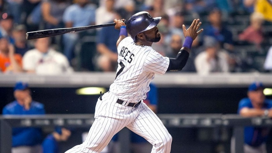 DENVER, CO - AUGUST 22: Jose Reyes #7 of the Colorado Rockies watches the flight of a sixth inning solo homerun against the New York Mets during a game at Coors Field on August 22, 2015 in Denver, Colorado. (Photo by Dustin Bradford/Getty Images)