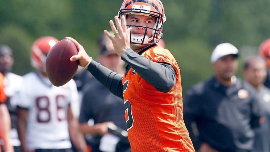 May 26, 2015; Cincinnati, OH, USA; Cincinnati Bengals quarterback AJ McCarron (5) looks to pass during OTAs at Paul Brown Stadium. Mandatory Credit: Aaron Doster-USA TODAY Sports