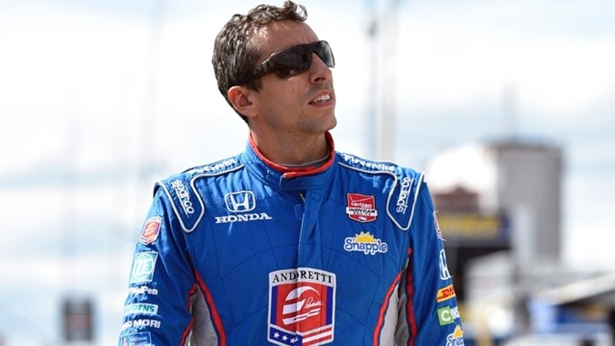 Aug. 22, 2015: Justin Wilson, of England, walks on pit road during qualifying for Sunday's Pocono IndyCar 500 auto race in Long Pond, Pa. Wilson was injured during Sunday's race and air lifted to the hospital. (AP Photo/Derik Hamilton)