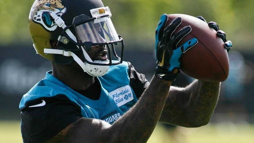 May 28, 2015; Jacksonville, FL, USA; Jacksonville Jaguars wide receiver Arrelious Benn (12) catches a pass during OTAs at the Florida Blue Health and Wellness Practice Fields. Mandatory Credit: Phil Sears-USA TODAY Sports