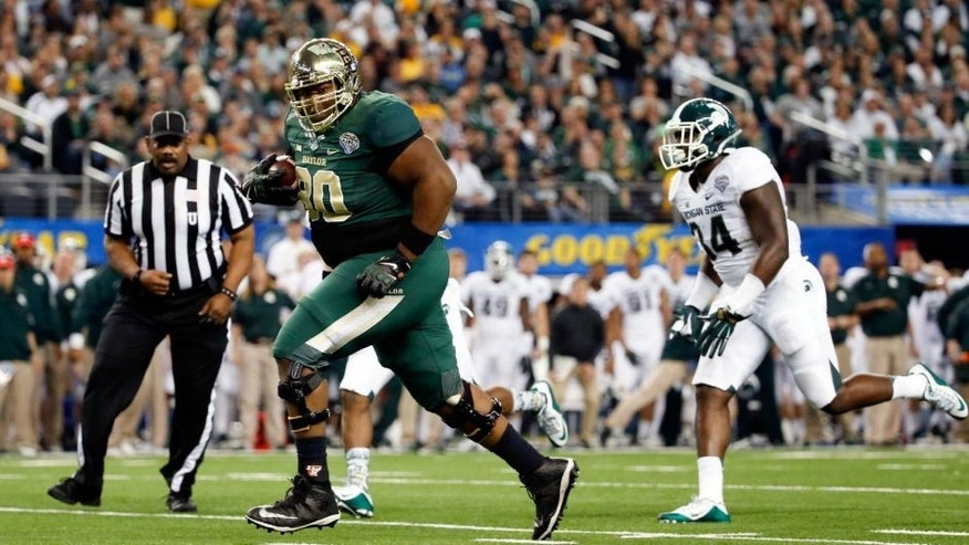 Jan 1, 2015; Arlington, TX, USA; Baylor Bears offensive lineman LaQuan McGowan (80) scores a touchdown during the game against the Michigan State Spartans in the 2015 Cotton Bowl Classic at AT&T Stadium. Mandatory Credit: Kevin Jairaj-USA TODAY Sports