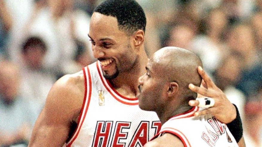 <p>MIAMI, : Miami Heat center Alonzo Mourning (L) and Tim Hardaway (R) celebrate as the New York Knicks called a time out with less than two seconds left after a basket by Heat forward Jamal Mashburn put them ahead in their second-round divisional playoff game 88-84. The Heat won by that score.</p>