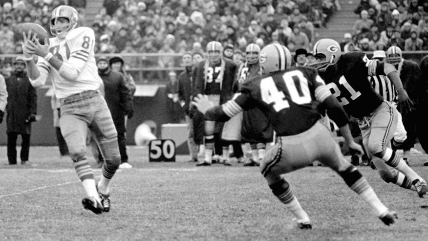 End Dave Parks of the San Francisco 49ers (81) catches a pass from quarterback John Brodie for an 11-yard gain in the second period of NFL game at County Stadium on Sunday, Dec. 4, 1966. Tom Brown (40) and Bob Jeter (21) of the Green Bay Packers poise for the tackle. (AP Photo)