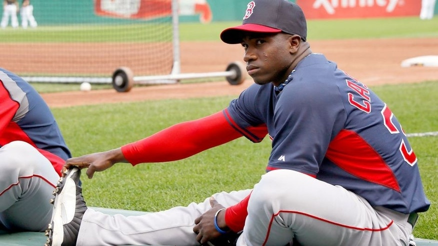 Boston Red Sox center fielder Rusney Castillo stretches before the baseball game against the Pittsburgh Pirates on Wednesday, Sept. 17, 2014, in Pittsburgh. Castillo is expected to make his Major League debut in the game. (AP Photo/Keith Srakocic)