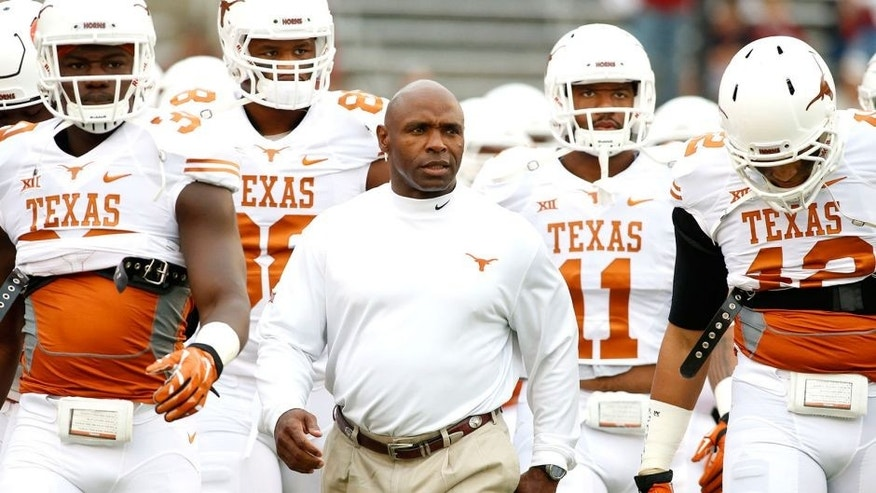 Oct 11, 2014; Dallas, TX, USA; Texas Longhorns head coach Charlie Strong takes the field with his team before the game against the Oklahoma Sooners at the Cotton Bowl. Mandatory Credit: Tim Heitman-USA TODAY Sports