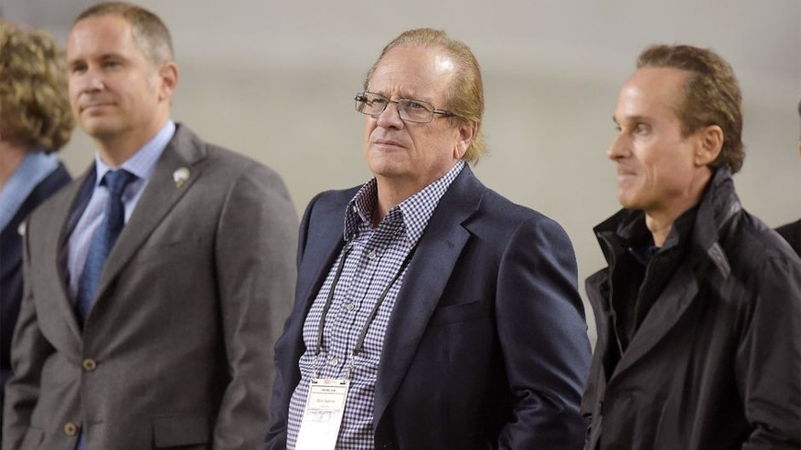 Dec 20, 2014; Santa Clara, CA, USA; San Diego Chargers president Dean Spanos (center) is flanked by chief executive officer A.G. Spanos (left) and executive vice president Michael Spanos during the game against the San Francisco 49ers at Levi's Stadium. Mandatory Credit: Kirby Lee-USA TODAY Sports