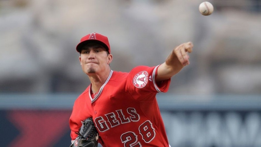 Los Angeles Angels starting pitcher Andrew Heaney throws against the New York Yankees during the first inning of a baseball game, Tuesday, June 30, 2015, in Anaheim, Calif. (AP Photo/Jae C. Hong)