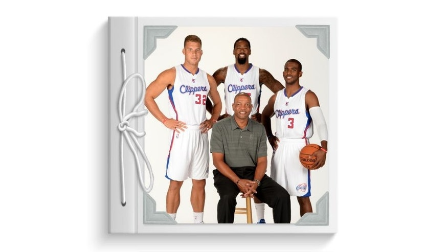 Doc Rivers, Blake Griffin #32, DeAndre Jordan #6 and Chris Paul #3 of the Los Angeles Clippers pose for a portrait during the Los Angeles Clippers Media Day at the Los Angeles Clippers Training Facility on September 29, 2014 in Playa Vista, California. Mandatory Copyright Notice: Copyright 2014 NBAE (Photo by Andrew D. Bernstein/NBAE via Getty Images)