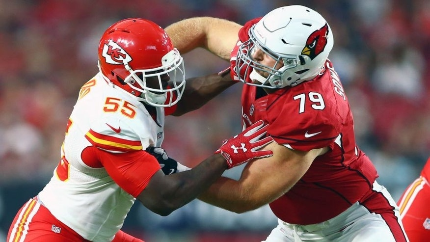 Aug 15, 2015; Glendale, AZ, USA; Kansas City Chiefs linebacker Dee Ford (left) battles against Arizona Cardinals tackle Bradley Sowell during a preseason NFL football game at University of Phoenix Stadium. Mandatory Credit: Mark J. Rebilas-USA TODAY Sports