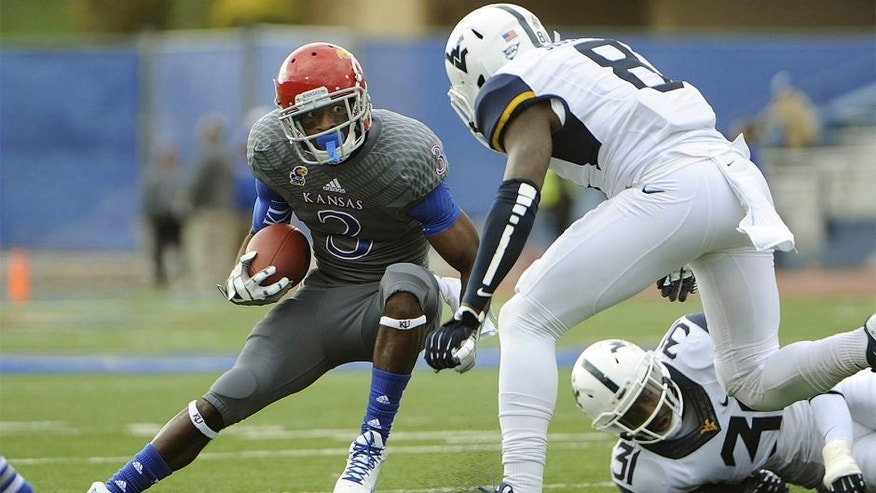 Nov 16, 2013; Lawrence, KS, USA; Kansas Jayhawks running back Tony Pierson (3) runs for yardage against West Virginia Mountaineers linebacker Isaiah Bruce (31) and safety Karl Joseph (8) in the first half at Memorial Stadium. Mandatory Credit: John Rieger-USA TODAY Sports
