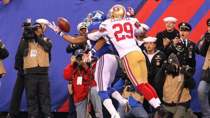 Nov 16, 2014; East Rutherford, NJ, USA; New York Giants wide receiver Rueben Randle (82) can't catch a pass in the end zone while defended by San Francisco 49ers corner back Chris Culliver (29) during the fourth quarter at MetLife Stadium. The 49ers defeated the Giants 16-10. Mandatory Credit: Brad Penner-USA TODAY Sports