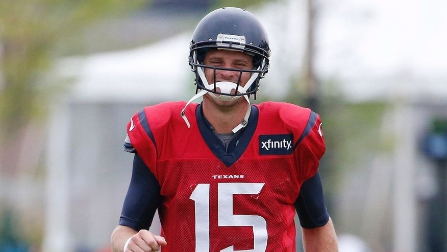 Aug 7, 2015; Richmond, VA, USA; Houston Texans quarterback Ryan Mallett (15) warms up during joint practice with the Washington Redskins as part of day eight of training camp at Bon Secours Washington Redskins Training Center. Mandatory Credit: Amber Searls-USA TODAY Sports