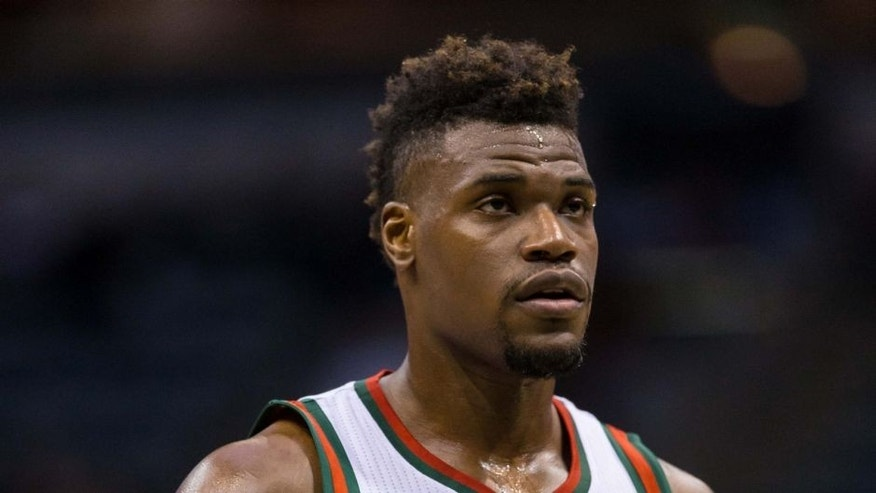 <p>Mar 5, 2014; Milwaukee, WI, USA; Milwaukee Bucks forward Jeff Adrien (12) during the game against the Sacramento Kings at BMO Harris Bradley Center. Sacramento won 117-102. Mandatory Credit: Jeff Hanisch-USA TODAY Sports</p>