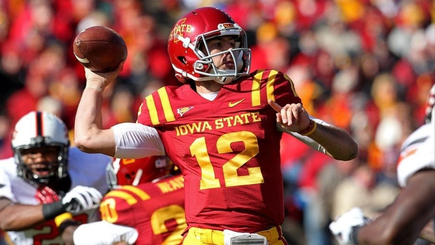 Oct 26, 2013; Ames, IA, USA; Iowa State Cyclones quarterback Sam B. Richardson (12) throws during the first quarter against the Oklahoma State Cowboys at Jack Trice Stadium. Mandatory Credit: Brace Hemmelgarn-USA TODAY Sports