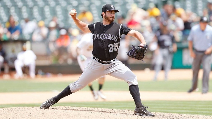 OAKLAND, CA - JULY 1: Chad Bettis #35 of the Colorado Rockies pitches during the game against the Oakland Athletics at O.co Coliseum on July 1, 2015 in Oakland, California. The Athletics defeated the Rockies 4-1. (Photo by Michael Zagaris/Oakland Athletics/Getty Images)
