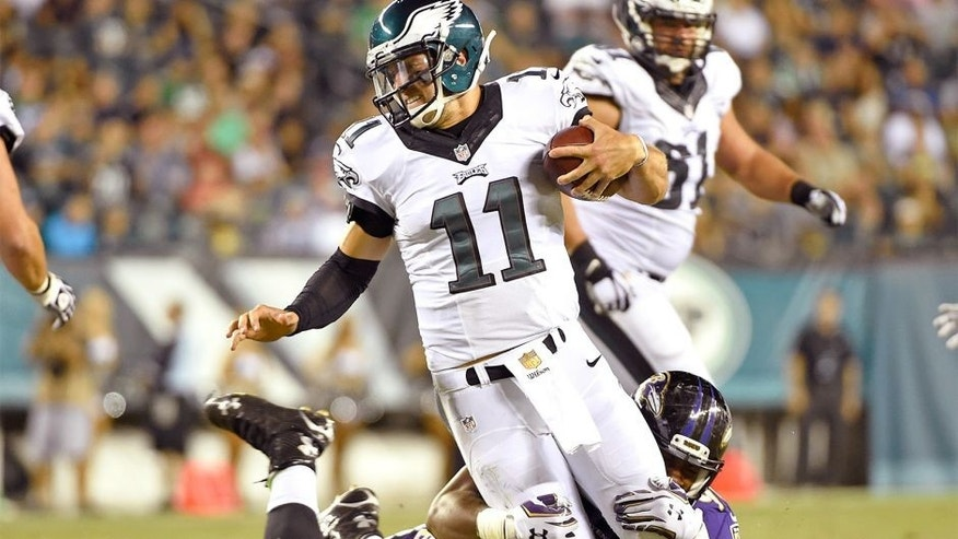 Aug 22, 2015; Philadelphia, PA, USA; Philadelphia Eagles quarterback Tim Tebow (11) is sacked by Baltimore Ravens linebacker Za'Darius Smith (90) during the second half at Lincoln Financial Field. The Eagles defeated the Ravens, 40-17. Mandatory Credit: Eric Hartline-USA TODAY Sports