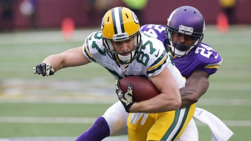 Green Bay Packers wide receiver Jordy Nelson (left) is tackled by Minnesota Vikings cornerback Captain Munnerlyn after making a reception during the second half.