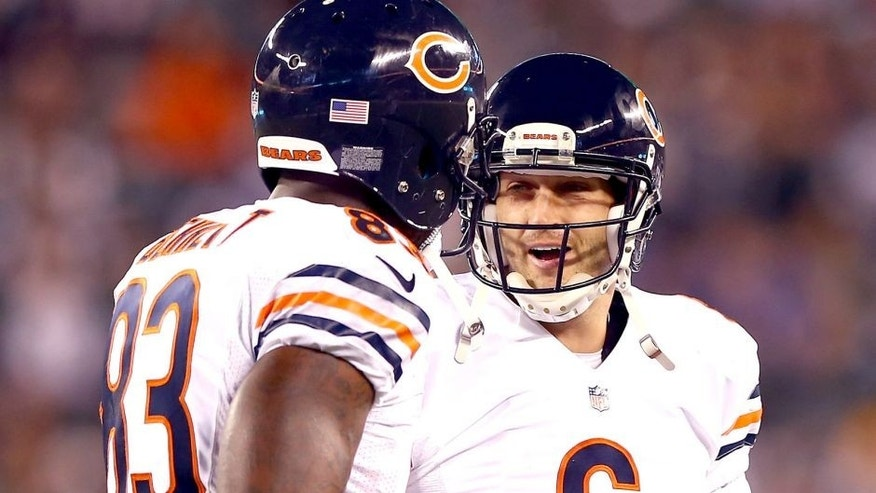 EAST RUTHERFORD, NJ - SEPTEMBER 22: Quarterback Jay Cutler #6 celebrates a touchdown with tight end Martellus Bennett #83 of the Chicago Bears against the New York Jets during a game at MetLife Stadium on September 22, 2014 in East Rutherford, New Jersey. (Photo by Elsa/Getty Images)