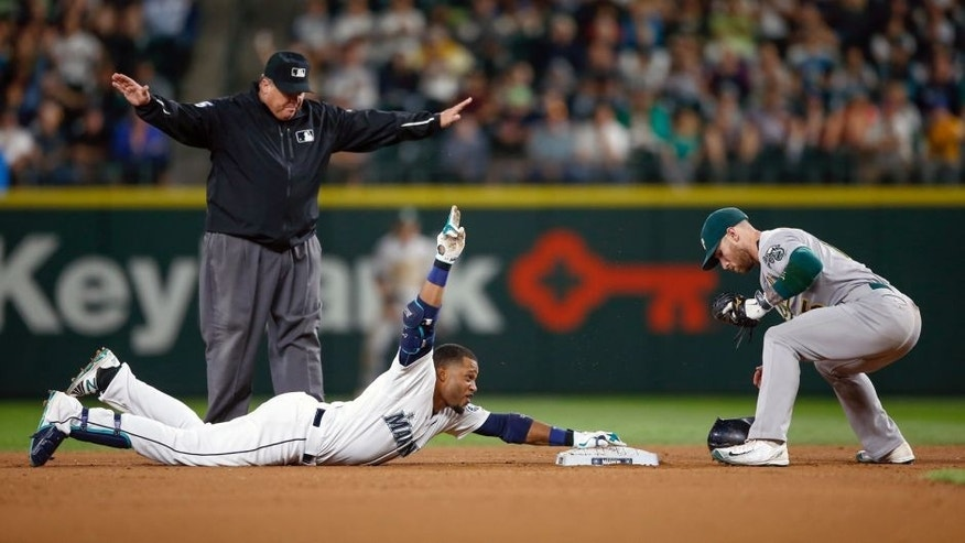 SEATTLE, WA - AUGUST 25: Robinson Cano #22 of the Seattle Mariners gestures after doubling against second baseman Brett Lawrie #15 of the Oakland Athletics in the seventh inning at Safeco Field on August 25, 2015 in Seattle, Washington. The double gave Cano 30 for 11 consecutive seasons. (Photo by Otto Greule Jr/Getty Images)