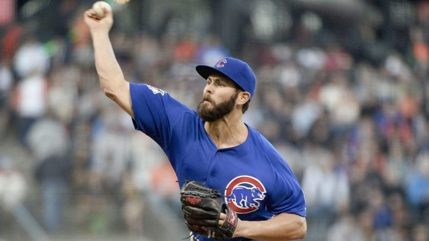 August 25, 2015; San Francisco, CA, USA; Chicago Cubs starting pitcher Jake Arrieta (49) delivers a pitch during the first inning against the San Francisco Giants at AT&T Park. Mandatory Credit: Kyle Terada-USA TODAY Sports
