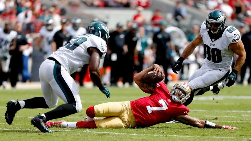 Sep 28, 2014; Santa Clara, CA, USA; San Francisco 49ers quarterback Colin Kaepernick (7) slides on the play against Philadelphia Eagles inside linebacker DeMeco Ryans (59) and outside linebacker Connor Barwin (98) during the first quarter at Levi's Stadium. Mandatory Credit: Kelley L Cox-USA TODAY Sports