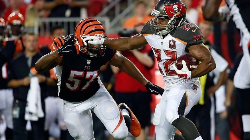 Aug 24, 2015; Tampa, FL, USA; Tampa Bay Buccaneers running back Doug Martin (22) runs with the ball as Cincinnati Bengals outside linebacker Vincent Rey (57) attempted to defend during the first quarter at Raymond James Stadium. Mandatory Credit: Kim Klement-USA TODAY Sports