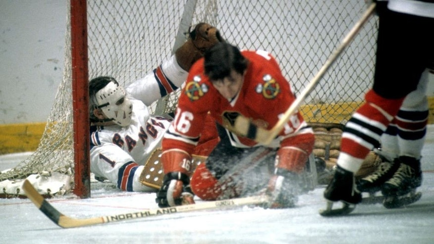 NEW YORK, NY - 1972: Goalie Ed Giacomin #1 of the New York Rangers is pushed into the net by Chico Maki #16 of the Chicago Blackhawks during their game circa 1972 at the Madison Square Garden in New York, New York. (Photo by Melchior DiGiacomo/Getty Images)