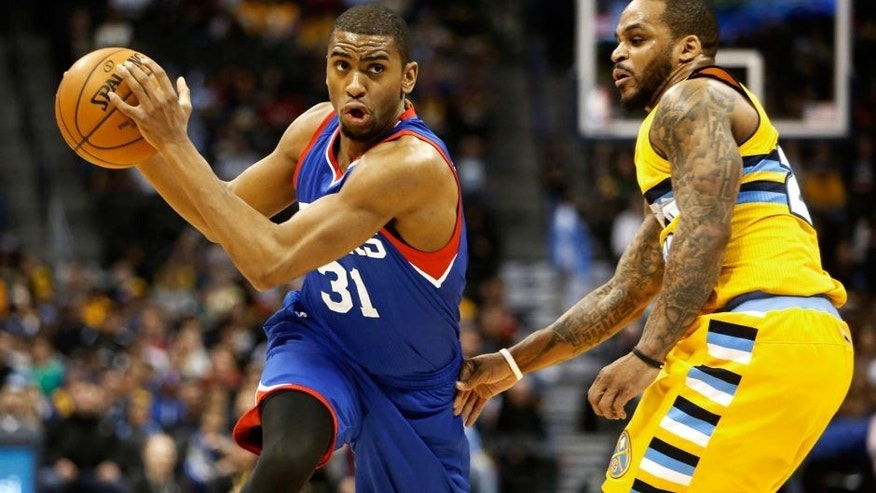 Mar 25, 2015; Denver, CO, USA; Philadelphia 76ers guard Hollis Thompson (31) drives to the basket past Denver Nuggets guard Jameer Nelson (28) during the second half at Pepsi Center. The 76ers won 99-85. Mandatory Credit: Chris Humphreys-USA TODAY Sports